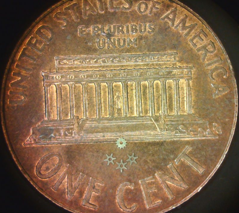 Stainless-Steel-gears-on-back-of-penny